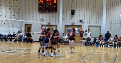 Leonia's Varsity volleyball team celebrates seconds after their victory against Dwight Englewood School.